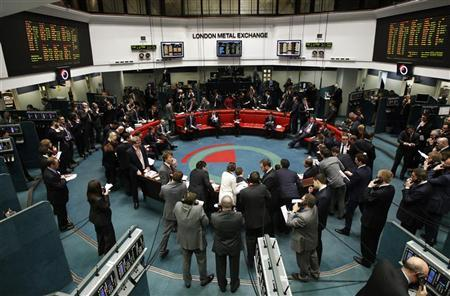 Traders and clerks react at the London Metal Exchange in the City of London